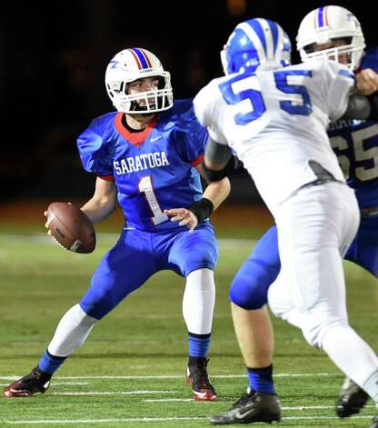 Saratoga's quarterback Brian Williams, left, looks to pass as Shaker's Matt Holmes defends during their Class AA football championship game on Friday, Nov. 6, 2015, at Shenendehowa High in Clifton Park, N.Y. (Cindy Schultz / Times Union) Photo: Cindy Schultz / 00034111A
