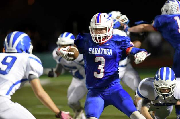 Saratoga's Ryan Manlapaz, center, carries the ball during their Class AA football championship game against Shaker on Friday, Nov. 6, 2015, at Shenendehowa High in Clifton Park, N.Y. (Cindy Schultz / Times Union) Photo: Cindy Schultz / 00034111A