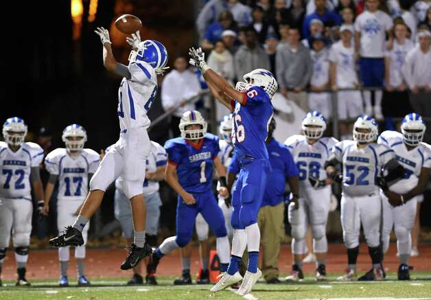 Shaker's Paul Kessler, left, attempts a reception as Saratoga's Robert Haughton defends during their Class AA football championship game on Friday, Nov. 6, 2015, at Shenendehowa High in Clifton Park, N.Y. (Cindy Schultz / Times Union) Photo: Cindy Schultz / 00034111A