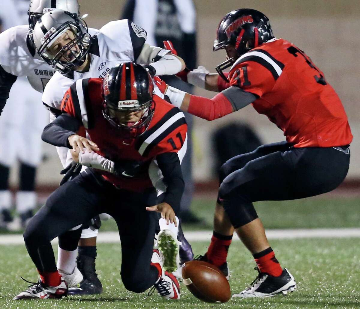 Stevens' Tristan Castaneda chases after a fumble after an interception on Clark's Tate Schorr (rear) as Stevens' Josh Contreras moves in on the play during first half action Friday Nov. 6, 2015 at Farris Stadium.