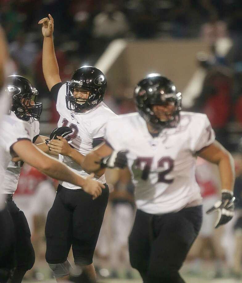 Pearland Oilers kicker Cody Bernstein (12) celebrates his game winning 38 yard field goal against the  Alvin Mustangs P in the fourth quarter at Alvin Memorial Stadium on Friday, November 6, 2015 in Alvin, TX. Pearland won 27 to 24.  (For the Chronicle: Thomas B. Shea) Photo: Thomas B. Shea / © 2015 Thomas B. Shea