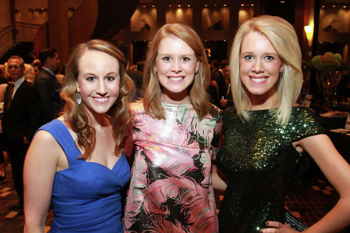 Sutton Staine, from left, Jessica Strake and Rebecca Malzahn at Una Notte in Italia, presented by Festari for Men and benefiting Bo's Place. (For the Chronicle/Gary Fountain, November 6, 2015)