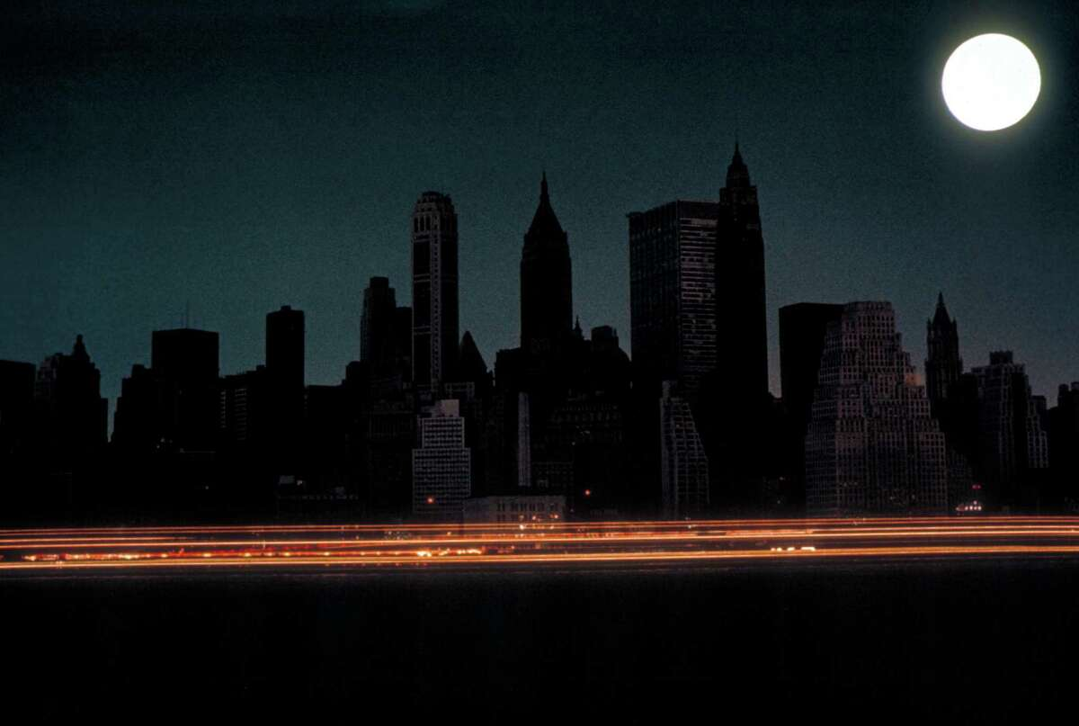 Bright full moon over darkened New York City skyline during massive East Coast blackout affecting 80,000 square miles. (Photo by Bob Gomel/The LIFE Images Collection/Getty Images)