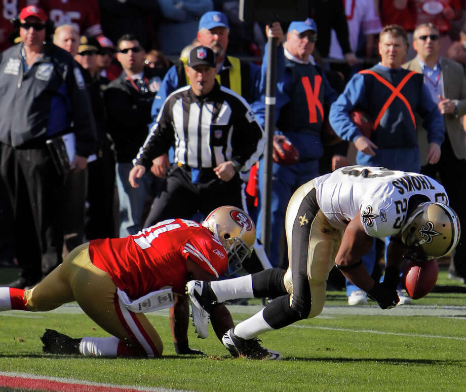 Pierre Thomas and Donte Whitner had a memorable collision in the a 2011 divisional-playoff game. Photo: Carlos Avila Gonzalez / The Chronicle / ONLINE_YES