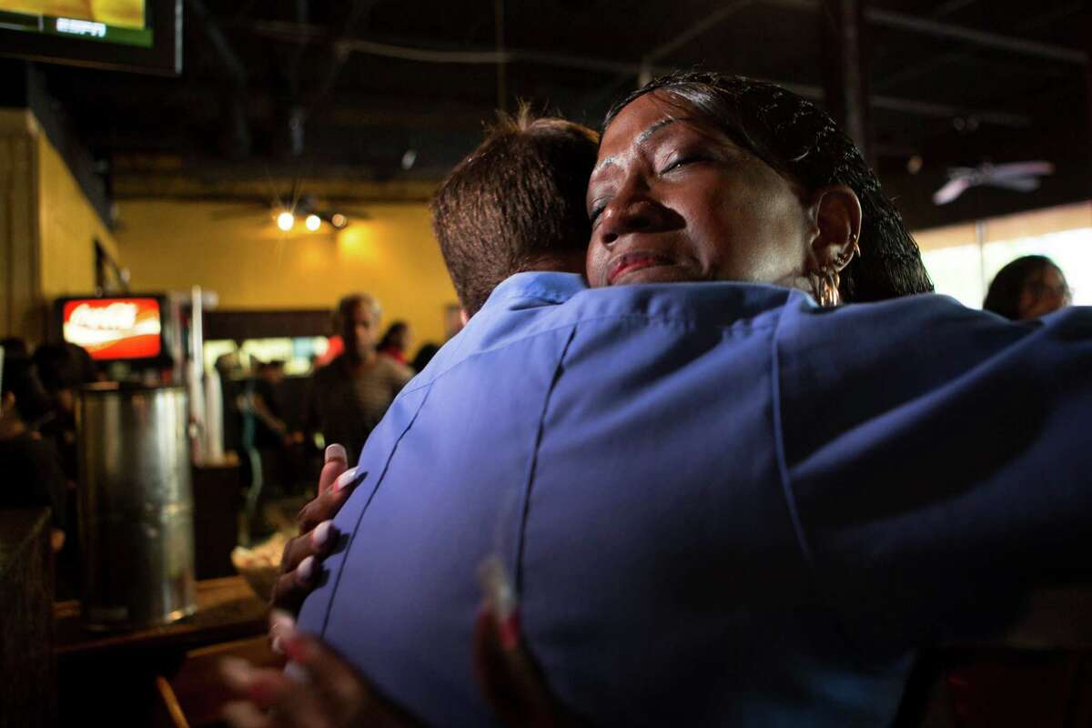 Jacqueline McKnight, 58, embraces Chris Weichlein who three years ago was part of the Houston Fire Department rescuers that resuscitated her after she suffered a cardiac arrest. Three years after the incident McKnight works at The Breakfast Klub and every time she identifies a HFD member, she thanks them for their service to the community. On Friday, Nov. 6, 2015, McKnight got to meet the rescuers that saved her life.