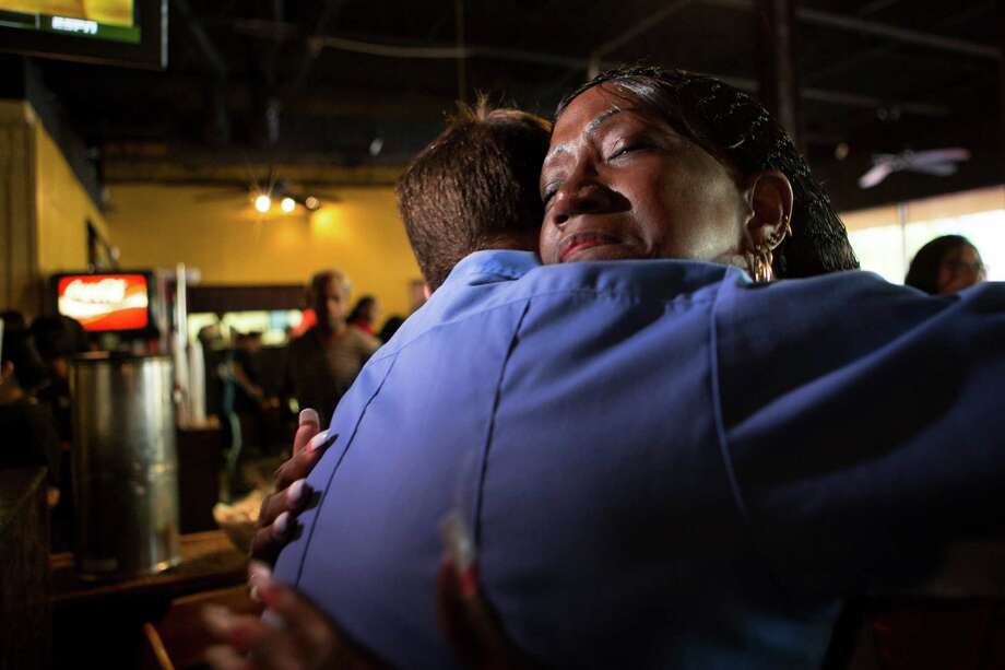 Jacqueline McKnight, 58, embraces Chris Weichlein who three years ago was part of the Houston Fire Department rescuers that resuscitated her after she suffered a cardiac arrest. Three years after the incident McKnight works at The Breakfast Klub and every time she identifies a HFD member, she thanks them for their service to the community. On Friday, Nov. 6, 2015, McKnight got to meet the rescuers that saved her life. Photo: Marie D. De Jesus, Houston Chronicle / © 2015 Houston Chronicle