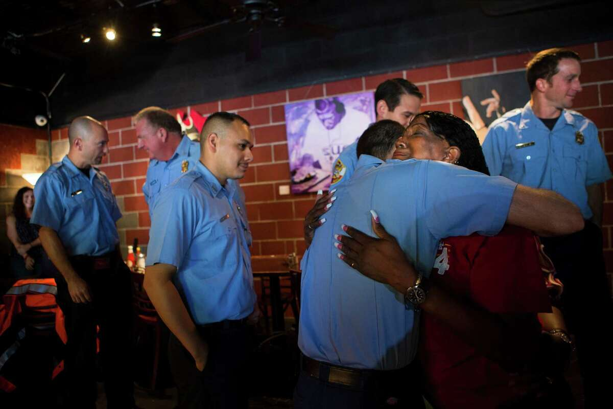 Jacqueline McKnight, 58, embraces Jeremy Smith who three years ago was part of the Houston Fire Department rescuers that resuscitated McKnight after she suffered a cardiac arrest.