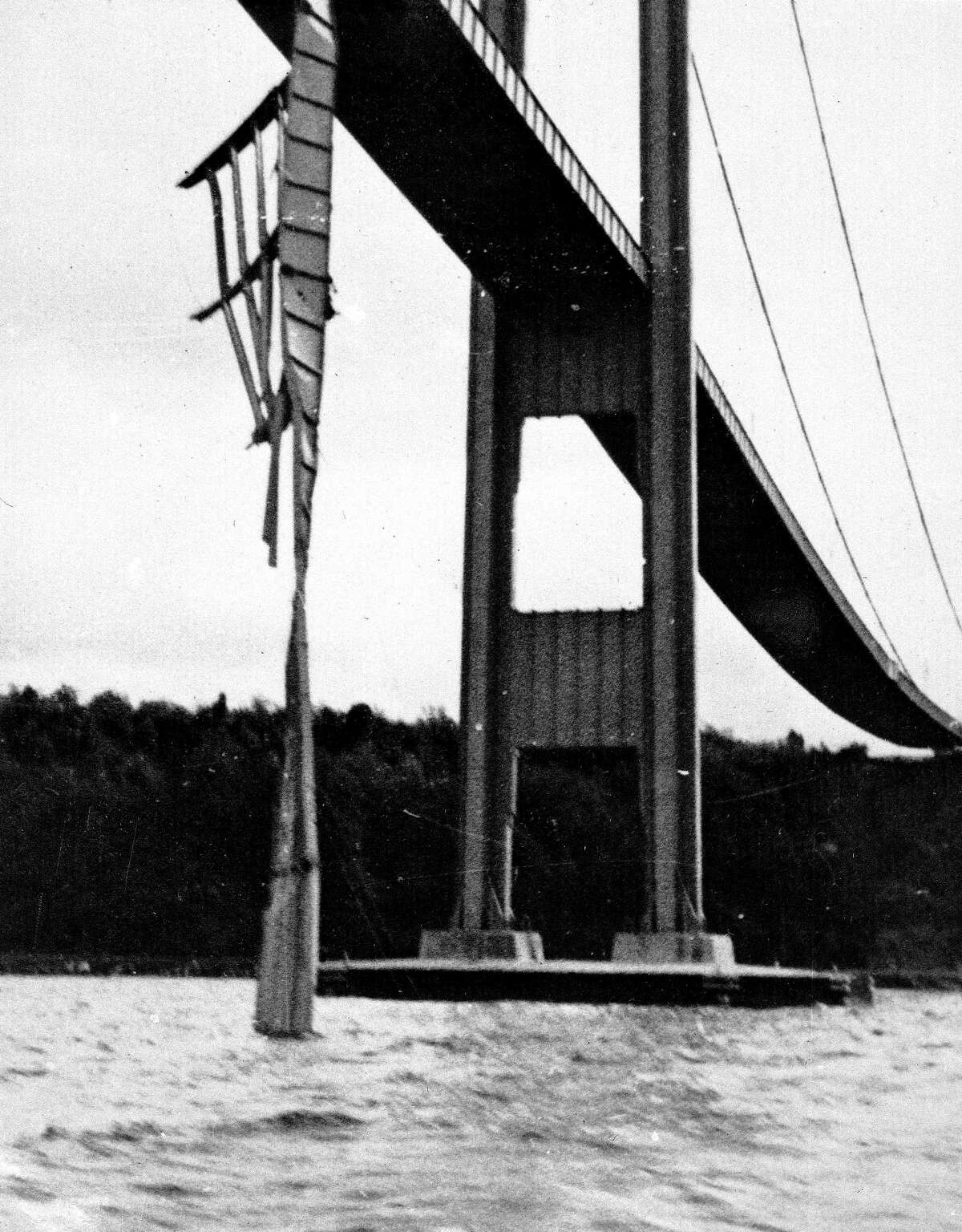 A part of the Tacoma Narrows Suspension bridge falls 190 feet into the Puget Sound after a gale wind swayed the bridge in Tacoma, Washington on Nov. 7, 1940.