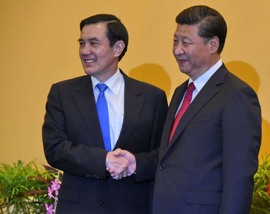 Taiwanese President Ma Ying-jeou (left) shakes hands with Chinese President Xi Jinping before their conference at the Shangri-la Hotel in Singapore. Photo: Roslan Rahman, AFP / Getty Images