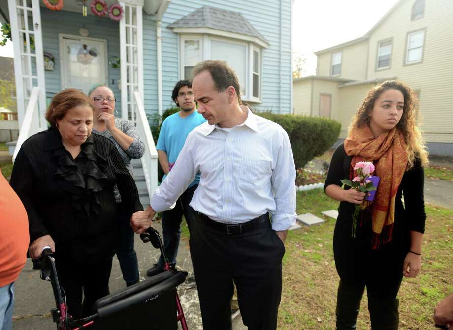 Mayor-elect Joseph P. Ganim visits the family of Miguel Arguelles, the victim of a fatal shooting, on Friday. Photo: Autumn Driscoll / Hearst Connecticut Media / Connecticut Post