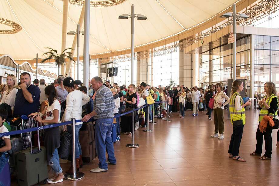 Tourists wait in slow-moving security lines at the Sharm el-Sheikh airport in Egypt as they try to board charter flights home. Many complained about a lack of information from travel agents. Photo: Vinciane Jacquet, Associated Press