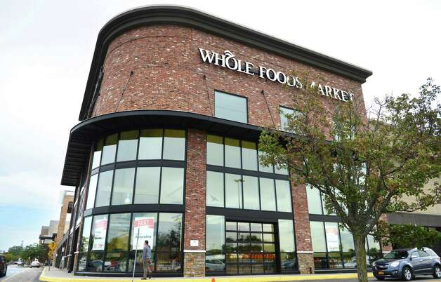 Exterior of the Whole Foods supermarket at Colonie Center Monday morning, Sept. 28, 2015, in Colonie, N.Y.  Grocery chain Whole Foods is cutting about 1,500 jobs over the next eight weeks as it looks to lower prices and keep up with competition. The cuts represent about 1.6 percent of its workforce. (Will Waldron/Times Union) Photo: Will Waldron / 00033534A