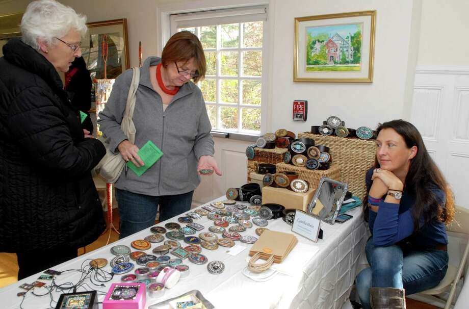 Bee Benbow and Anna Morgan shop at Camilla Klein's booth of handmade belt buckles at the Woman's Club of Greenwich (Conn.) annual Holiday Boutique on Friday November 15, 2013. Photo: Dru Nadler / Dru Nadler / Stamford Advocate Freelance