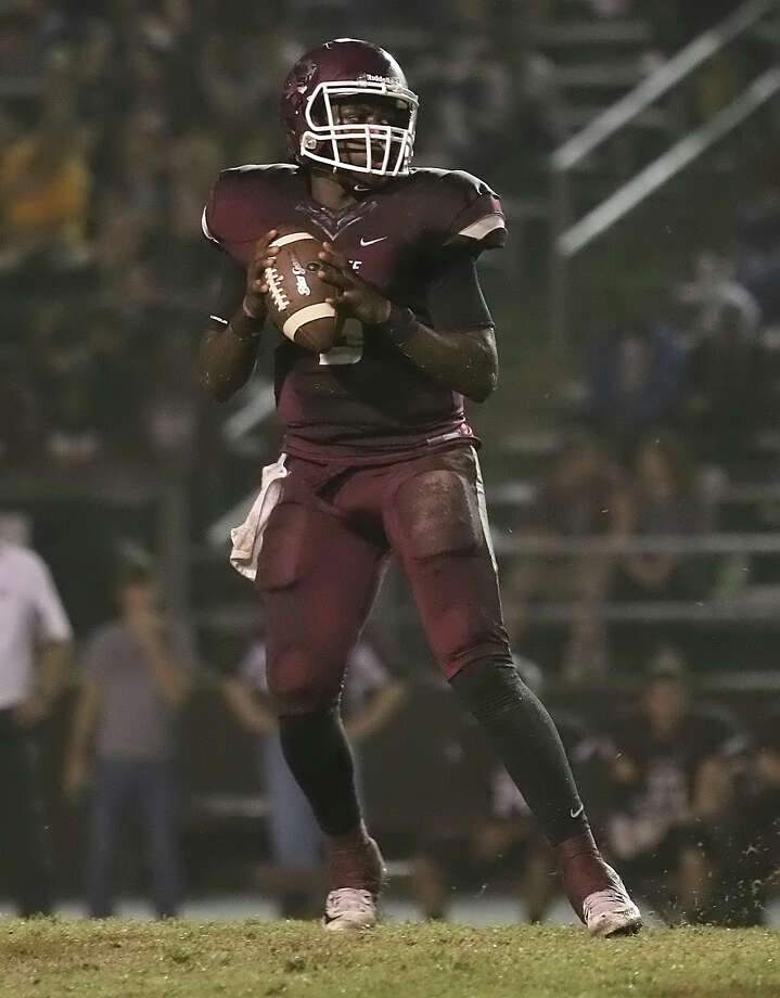 Dontre Thomas, 5,  looks to pass during the game between the Silsbee Tigers and the Jasper Bulldogs at Tiger Stadium in Silsbee, Friday night November 6th, 2015 - Photo provided by Kyle Ezell