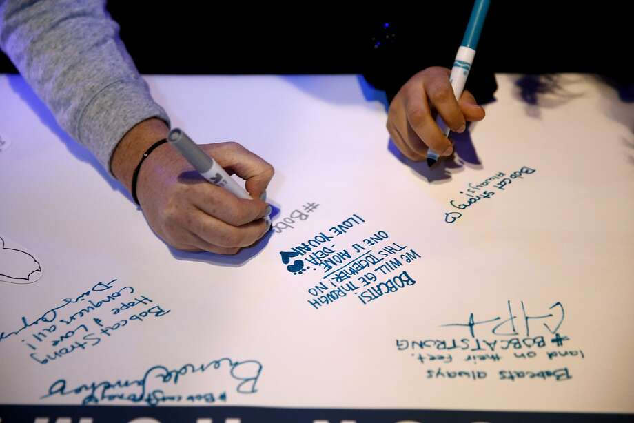 Students sign a banner during a vigil at UC Merced. Photo: Connor Radnovich, The Chronicle