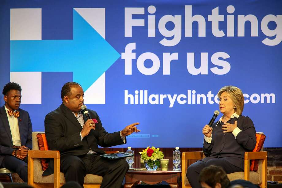 Democratic presidential candidate Hillary Rodham Clinton responds to a question from Roland Martin during a town hall meeting hosted by the South Carolina Legislative Black Caucus. Photo: Richard Burkhart, Associated Press