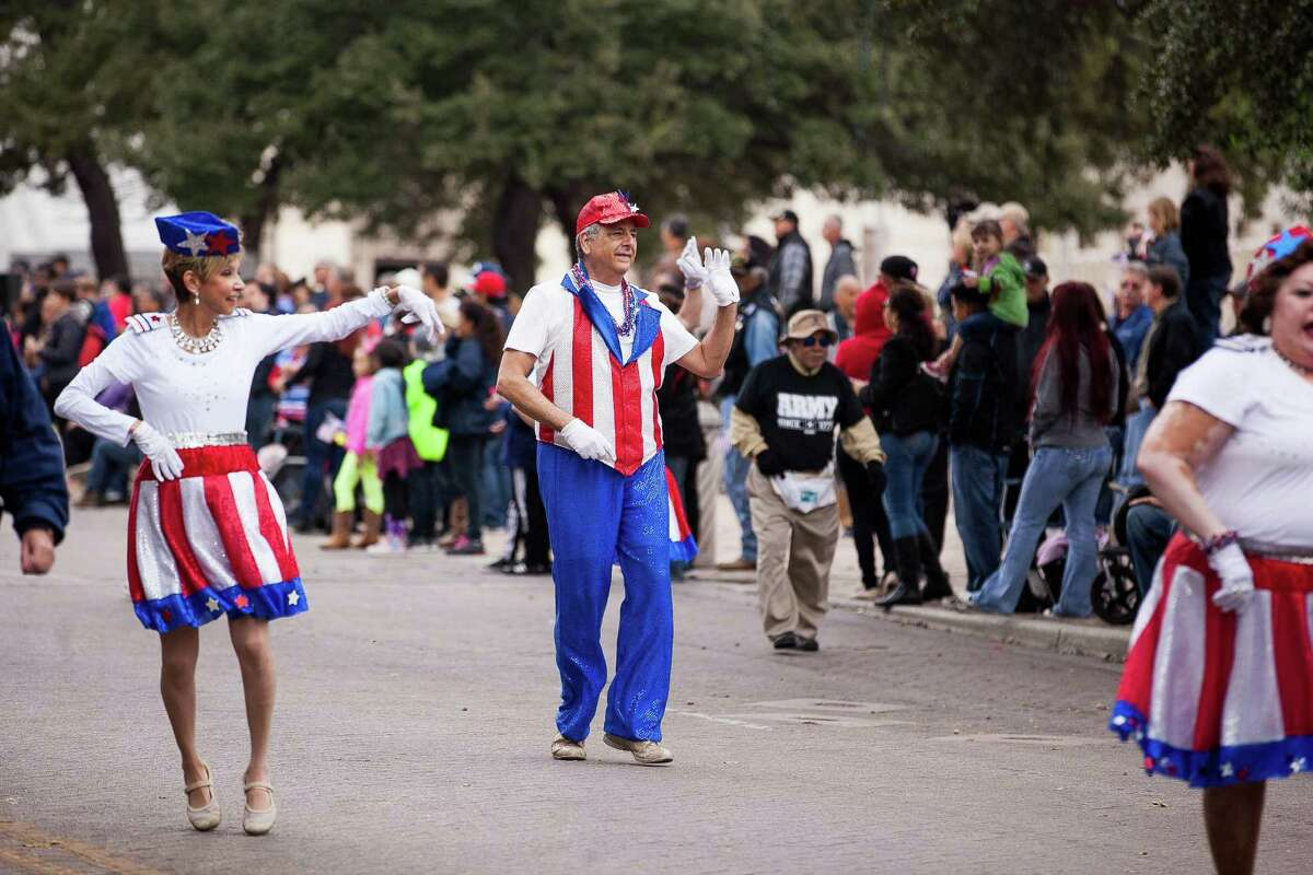 Destino Danzzar Performance Group dances during the U.S. Military Veterans Parade Saturday, Nov. 7, 2015 in front of the Alamo. The Veterans Day parade is known as the biggest in Texas as veterans, active-duty members and their families and friends participate in the parade parade since Veterans Day 2000.