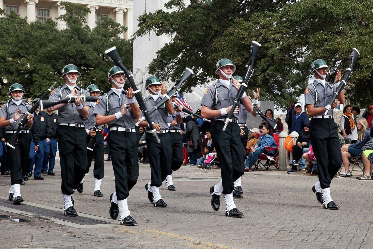 Ronald Reagan High School Rattler JROTC at the U.S. Military Veterans Parade Saturday, Nov. 7, 2015 in front of the Alamo. The Veterans Day parade is known as the biggest in Texas as veterans, active-duty members and their families and friends participate in the parade parade since Veterans Day 2000.