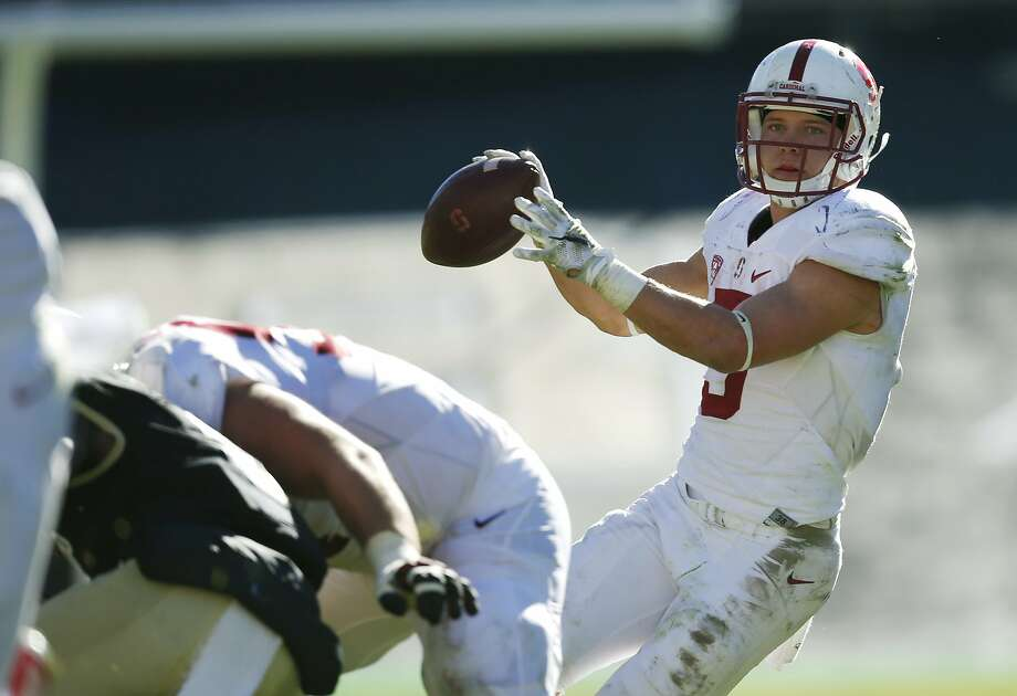 Running back Christian McCaffrey prepares to throw a touchdown pass to tight end Austin Hooper against Colorado. Photo: David Zalubowski, Associated Press