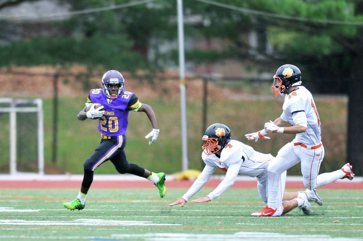 Westhill's Malik Lauture rounds the corner for a long run during a Saturday afternoon game against Ridgefield at Westhill High School on Nov. 7, 2015.