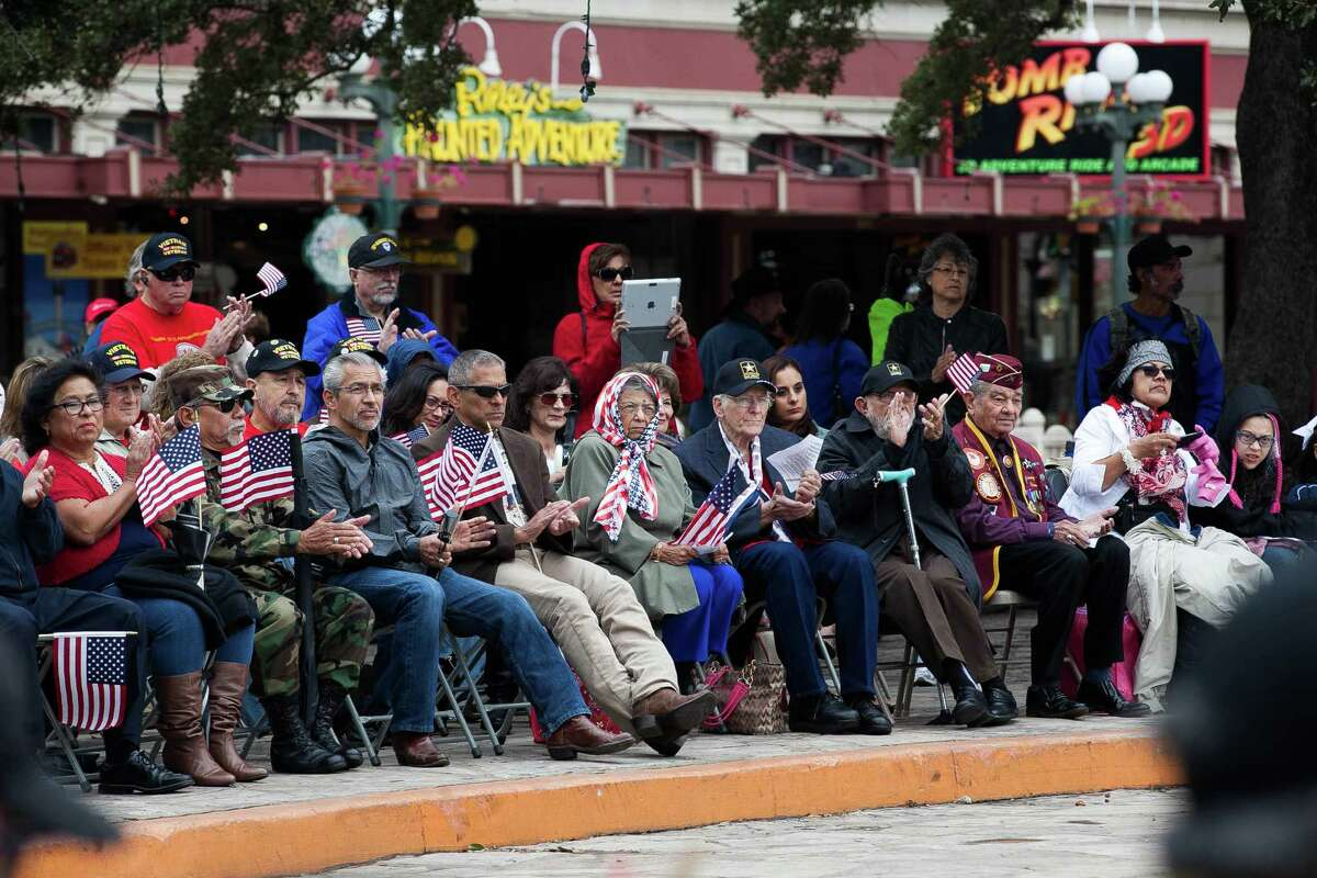 Audience listens to speakers during the wreath-laying ceremony Saturday, Nov. 7, 2015 in front of the Alamo. The Veterans Day parade is known as the biggest in Texas as veterans, active-duty members and their families and friends participate in the parade parade since Veterans Day 2000.