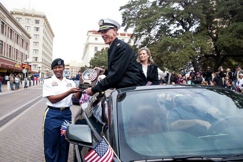 Captain Jim LeTexier, is presented with a plaque during the U.S. Military Veterans Parade Saturday, Nov. 7, 2015 in front of the Alamo. The Veterans Day parade is known as the biggest in Texas as veterans, active-duty members and their families and friends participate in the parade parade since Veterans Day 2000. / Julysa Sosa/For the San Antonio Express-News