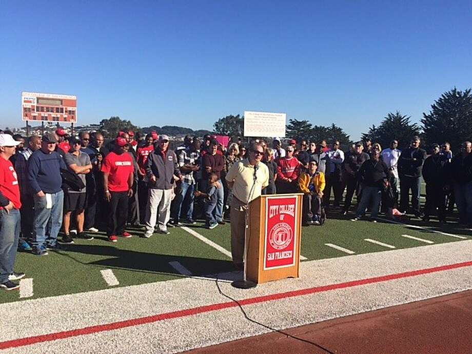 Backed by his family and dozens of his former players, George Rush addresses the crowd during a halftime ceremony at CCSF on Saturday. The school renamed its football stadium George M. Rush Stadium. He spent 38 seasons as the Rams' head coach before retiring in January. In the game, CCSF routed De Anza 41-10. Photo: Steve Kroner, The Chronicle