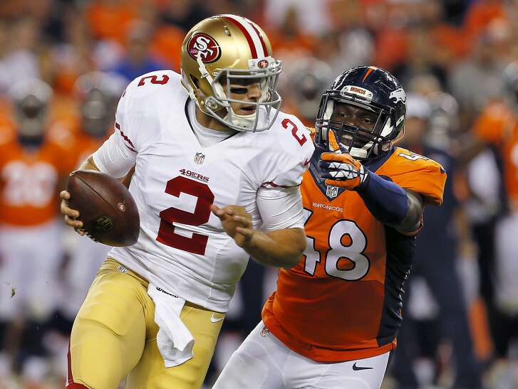 FILE - In this Aug. 29, 2015, file photo, San Francisco 49ers quarterback Blaine Gabbert (2) tries to escape the reach of Denver Broncos linebacker Shaquil Barrett (48) during the second half of an NFL preseason football game in Denver. A person with knowledge of the decision says quarterback Colin Kaepernick has been told he won't start Sunday, Nov. 8, for the 49ers, replaced by backup Gabbert. The person spoke on condition of anonymity Monday, Nov. 2 night because the decision wasn't to be discussed publicly. (AP Photo/Joe Mahoney, File)