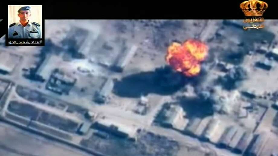 """An image grab taken from the Jordanian TV on February 5, 2015 shows flames erupting from a building hit by an airstrike against Islamic State (IS) group by warplanes of the Jordanian Air forces eagles at an undisclosed location. Jordan said its warplanes launched dozens of new strikes against the IS group """"hitting training camps of the terrorist groups as well as weapons and ammunition warehouses"""", in response to the burning alive of a Jordanian pilot captured in Syria. AFP PHOTO/JORDANIAN TV === RESTRICTED TO EDITORIAL USE - MANDATORY CREDIT """"AFP PHOTO / JORDANIAN TV"""" - NO MARKETING NO ADVERTISING CAMPAIGNS - DISTRIBUTED AS A SERVICE TO CLIENTS ===-/AFP/Getty Images Photo: -, Handout / AFP / Getty Images / AFP"""