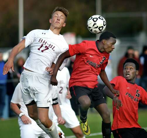 Burnt Hills' Justin Ariel, left, battles Fowler's Mupenzi Irakiza, center, in their Class A regional soccer game on Saturday, Nov. 7, 2015, at Colonie High in Colonie, N.Y. (Cindy Schultz / Times Union) Photo: Cindy Schultz / 00034117A