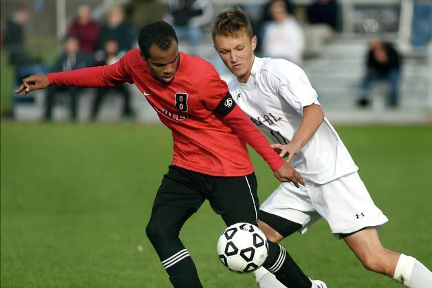 Burnt Hills' Justin Ariel, right, battles Fowler's keeper Abdullah Abdelkareem for the ball in their Class A regional soccer game on Saturday, Nov. 7, 2015, at Colonie High in Colonie, N.Y. (Cindy Schultz / Times Union) Photo: Cindy Schultz / 00034117A