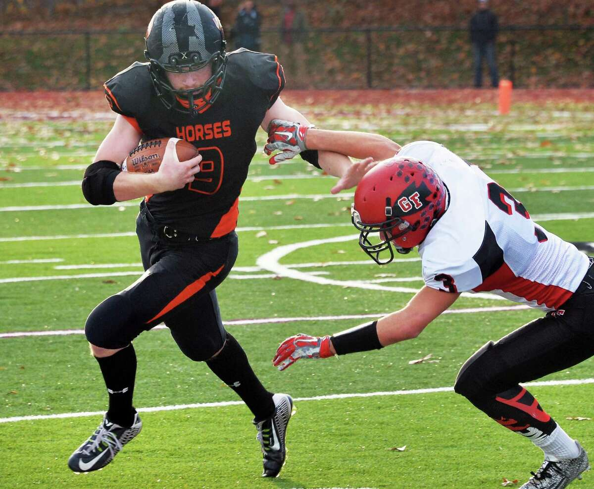 Schuylerville's #9 Skyler Bateman, left, breaks free of Glens Falls' #3 Andrew Murphy during Saturday's Class B championship game Nov. 7, 2015 in Burnt Hills, NY. (John Carl D'Annibale / Times Union)