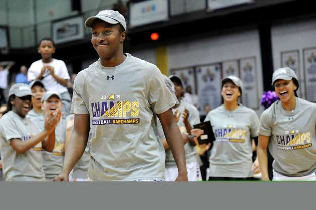UAlbany's Shereesha Richards, center, is named Most Outstanding Player following their 84-75 win over Hartford in their America East Championship game on Friday, March 13, 2015, at UAlbany in Albany, N.Y. (Cindy Schultz / Times Union) Photo: Cindy Schultz / 00030992A