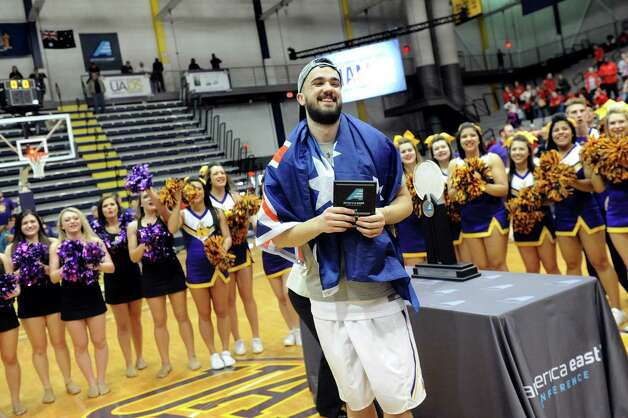 UAlbany's Peter Hooley, center, receives the award for Most Outstanding Player following their America East Championship game against Stony Brook on Saturday, March 13, 2015, at UAlbany in Albany, N.Y. (Cindy Schultz / Times Union) Photo: Cindy Schultz / 00030954A