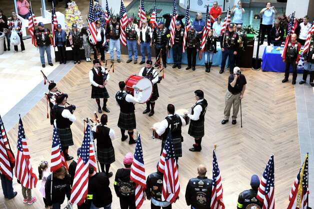 City of Albany Pipe Band joins Patriot Guard Riders during an event to honor veterans and build support for the Holiday Military Support Drive, which sends freedom boxes to troops overseas, on Saturday, Nov. 7, 2015, at Colonie Center in Colonie, N.Y. (Cindy Schultz / Times Union) Photo: Cindy Schultz