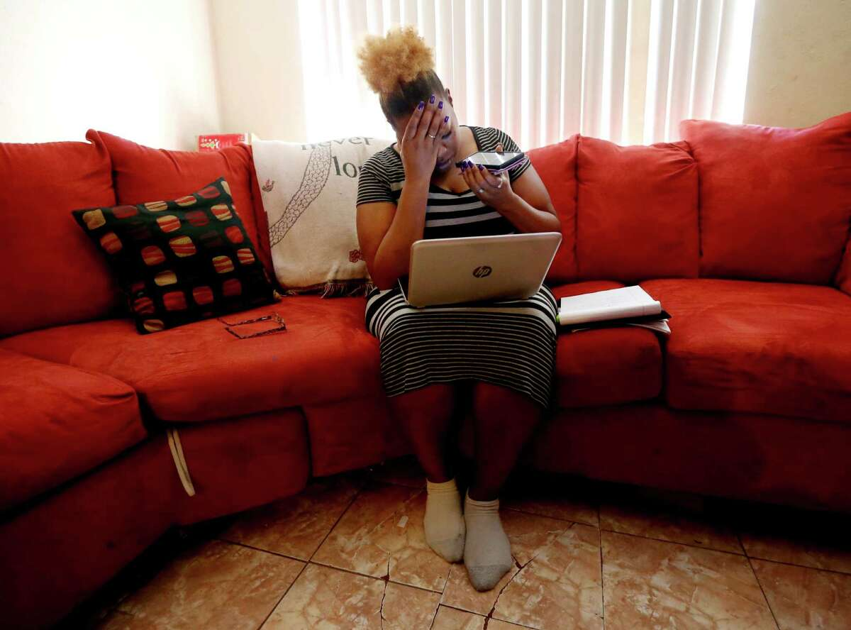 Jessica Vaughn, 35, a single mother of four, shows her frustration after finding out an apartment she had hoped to rent was not available until Nov. 1, past the Oct. 21 deadline to use a housing choice voucher from the Harris County Housing Authority.