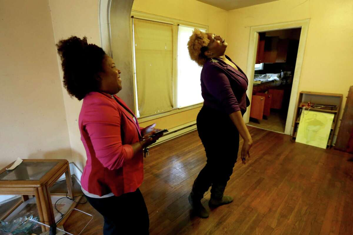 Jessica Vaughn, right, is relieved to know she will be renting her aunt's two- bedroom home after cousin Tonya Bias came up with the last-minute idea.