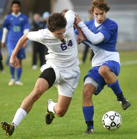 Ballston Spa's Jack Fitzgerald, left, battles Cicero's Cameron Houser for the ball during in their Class AA regional soccer game on Saturday, Nov. 7, 2015, at Colonie High in Colonie, N.Y. (Cindy Schultz / Times Union) Photo: Cindy Schultz / 00034116A