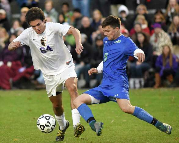 Ballston Spa's Jack Fitzgerald, left, battles Cicero's Matt Pike for the ball during in their Class AA regional soccer game on Saturday, Nov. 7, 2015, at Colonie High in Colonie, N.Y. (Cindy Schultz / Times Union) Photo: Cindy Schultz / 00034116A