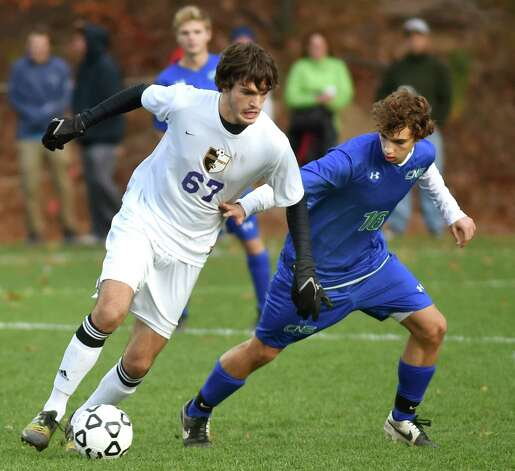 Ballston Spa's Connor DeFilippis, left, controls the ball as Cicero's Cameron Houser defends during in their Class AA regional soccer game on Saturday, Nov. 7, 2015, at Colonie High in Colonie, N.Y. (Cindy Schultz / Times Union) Photo: Cindy Schultz / 00034116A