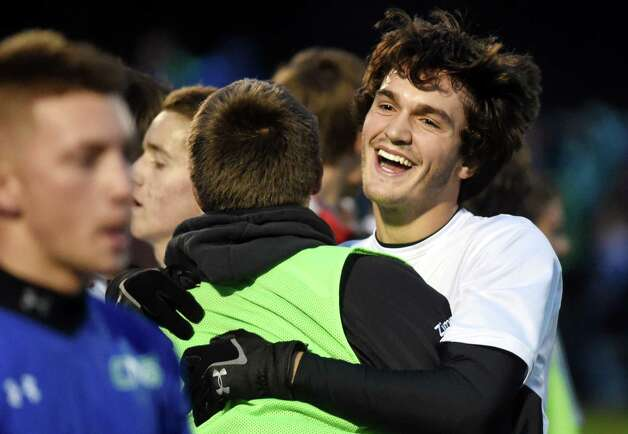 Ballston Spa's Connor DeFilippis, right, celebrates their 1-0 win over Cicero in the Class AA regional soccer game on Saturday, Nov. 7, 2015, at Colonie High in Colonie, N.Y. (Cindy Schultz / Times Union) Photo: Cindy Schultz / 00034116A