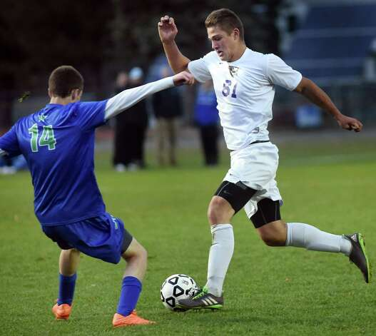 Ballston Spa's Patrick Haller, right, controls the ball as Cicero's Austin Mizell defends during their Class AA regional soccer game on Saturday, Nov. 7, 2015, at Colonie High in Colonie, N.Y. (Cindy Schultz / Times Union) Photo: Cindy Schultz / 00034116A