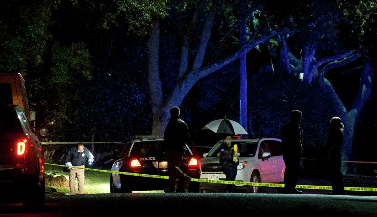 Authorities investigate the scene Saturday, Nov. 7, 2015, where District Judge Julie Kocurek was shot on Friday night in the driveway of her home in Austin, Texas. (Jay Janner/Austin American-Statesman via AP) AUSTIN CHRONICLE OUT, COMMUNITY IMPACT OUT, INTERNET AND TV MUST CREDIT PHOTOGRAPHER AND STATESMAN.COM, MAGS OUT; MANDATORY CREDIT
