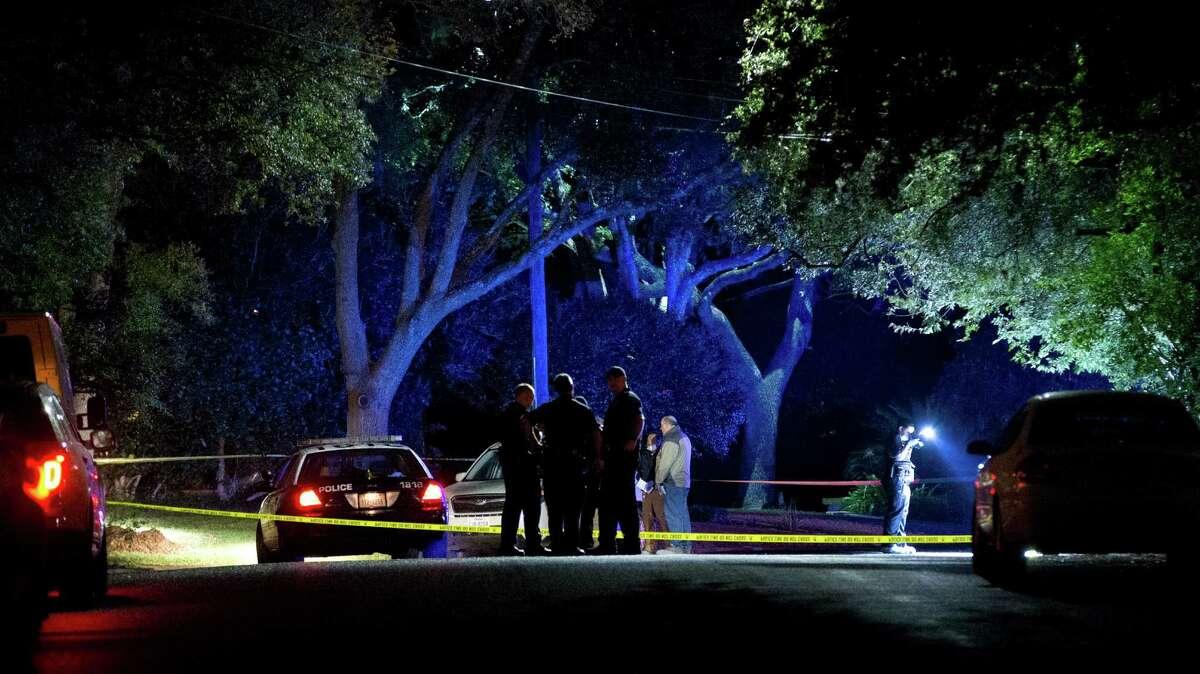 Police investigate the scene in Austin where state District Judge Julie Kocurek was shot.