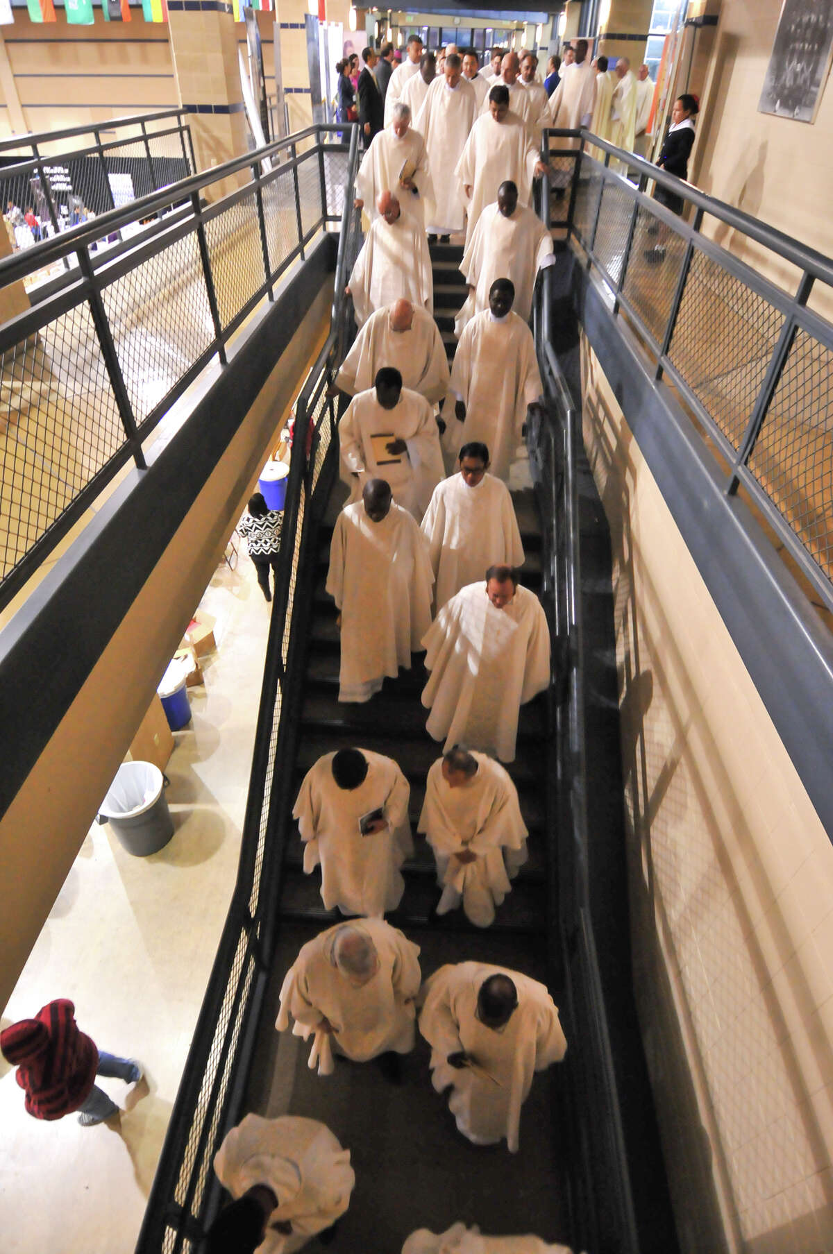 """Priests make their way to Greehey Arena at St. Mary's University for a Mass that concludes """"Assembly 2015."""""""