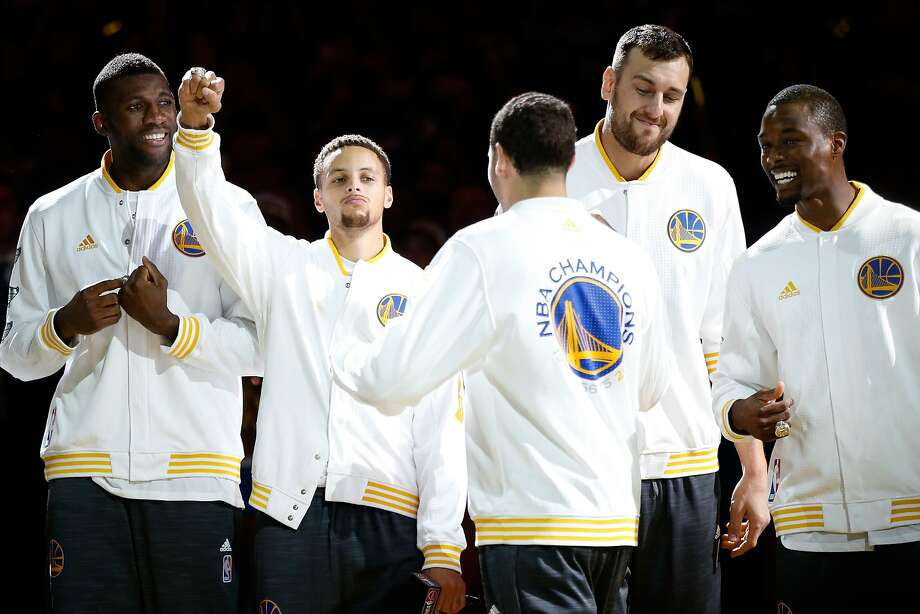OAKLAND, CA - OCTOBER 27:  Festus Ezeli #31, Stephen Curry #30, Klay Thompson #11, Andrew Bogut #12 and Harrison Barnes #40 of the Golden State Warriors celebrate after receiving their championship rings prior to their game against the New Orleans Pelicans in the NBA season opener at ORACLE Arena on October 27, 2015 in Oakland, California. NOTE TO USER: User expressly acknowledges and agrees that, by downloading and or using this photograph, User is consenting to the terms and conditions of the Getty Images License Agreement.  (Photo by Ezra Shaw/Getty Images) Photo: Ezra Shaw, Getty Images
