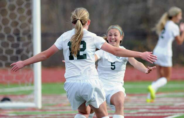 Schalmont's Molly Older, left, celebrates scoring a goal with teammate Davia Rossi during their Class B soccer regional girl's high school soccer game against Beekmantown on Saturday Nov. 7, 2015 in Stillwater, N.Y.  (Michael P. Farrell/Times Union) Photo: Michael P. Farrell / 00034119A
