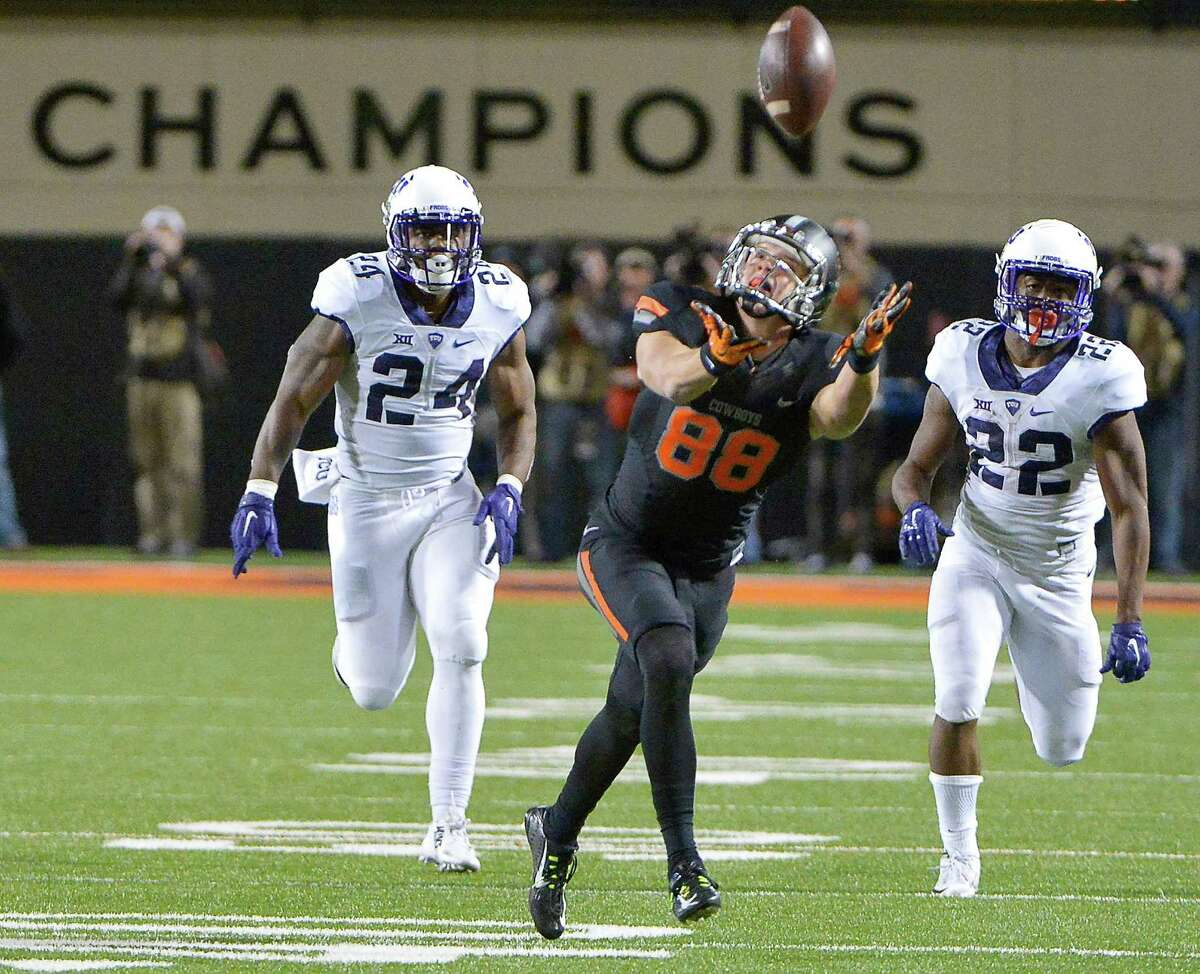 Oklahoma State wide receiver Austin Hays (88) is able to come down with the on-side kickoff attempt during the fourth quarter against TCU at Boone Pickens Stadium in Stillwater, Okla., on Saturday, Nov. 7, 2015. The host Cowboys won, 49-29. (Max Faulkner/Fort Worth Star-Telegram/TNS)