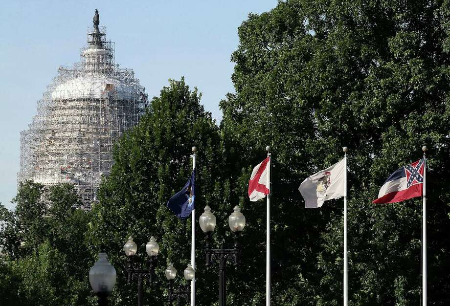 WASHINGTON, DC - JUNE 24: The state flag of Mississippi, which incorporates the flag of the Confederate States of America in the top left corner, is displayed with the flags of the other 49 states and territories in front of Union Station near the US Capitol June 24, 2015 in Washington, DC. In the wake of an apparently racist shooting that left nine African Americans dead in Charleston, South Carolina, Gov. Nikki Haley has asked that the confederate flag, also known as the 'Stars and Bars,' be taken down from in front of the state capitol building, adding political pressure to Mississippi to remove the charged symbol from its flag..(Photo by Mark Wilson/Getty Images) Photo: Mark Wilson, Staff / Getty Images / 2015 Getty Images