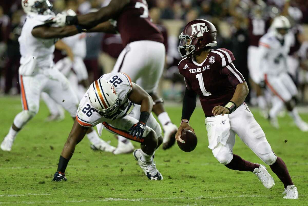 Kyler Murray of the Texas A&M Aggies avoids a sack attempt by Justin Garrett (26) of the Auburn Tigers at Kyle Field on Nov. 7, 2015, in College Station.